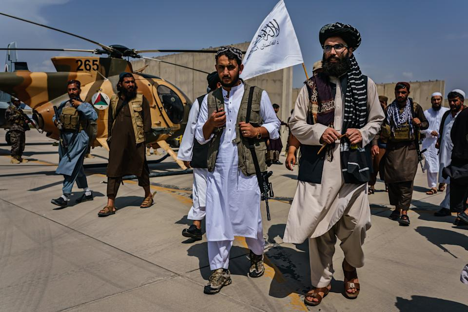 Anas Haqqani, center right, claimed western forces damaged Kabul airport during their evacuation. (Getty)