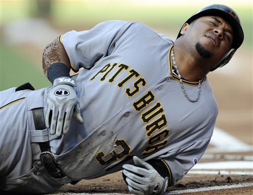 Pittsburgh Pirates' Jose Tabata grimaces in pain after getting hit with a pitch from Philadelphia Phillies' Vance Worley in the first inning of a baseball game, Tuesday, June 26, 2012, in Philadelphia. (AP Photo/Michael Perez)