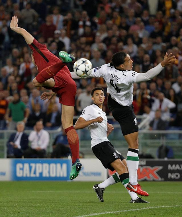 Soccer Football - Champions League Semi Final Second Leg - AS Roma v Liverpool - Stadio Olimpico, Rome, Italy - May 2, 2018 Liverpool's Virgil van Dijk in action with Roma's Edin Dzeko REUTERS/Max Rossi