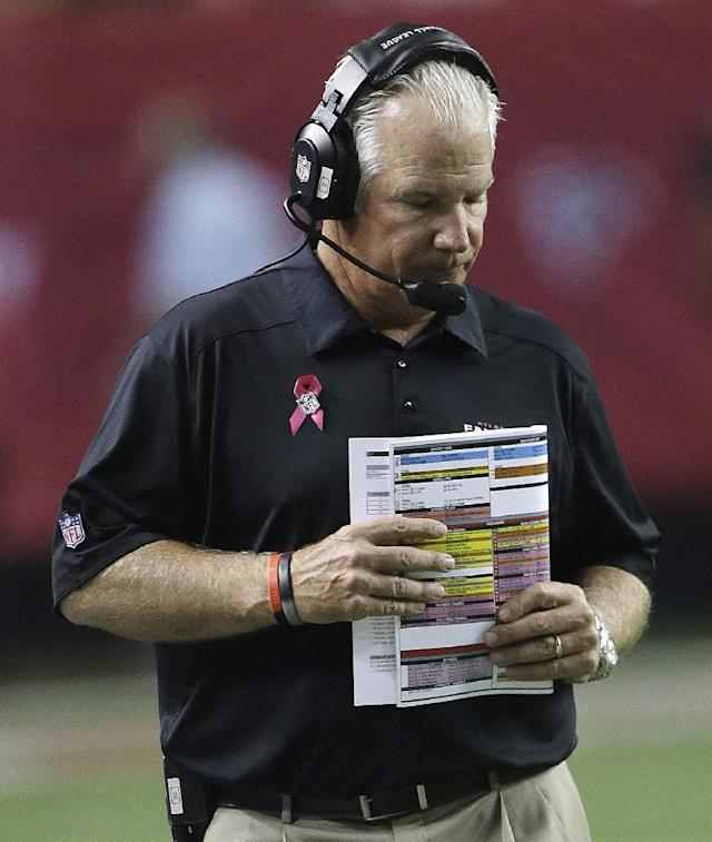Atlanta Falcons head coach Mike Smith walks the sidelines during the second half of an NFL football game against the New York Jets, Monday, Oct. 7, 2013, in Atlanta. (AP Photo/John Bazemore)