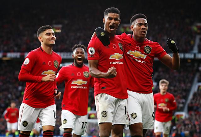 Rashford celebrates United's third with his teammates (Photo by Martin Rickett/PA Images via Getty Images)
