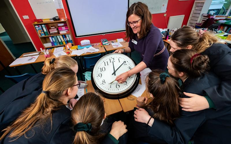 Head of Maths, Mrs Stephanie Speed, during her class aimed at teaching pupils at Kilgraston School for Girls, Bridge of Earn, how to tell the time using an analogue clock, - ©Stuart Nicol Photography