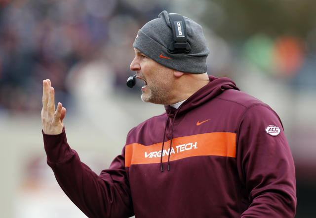 FILE - In this Nov. 23, 2018, file photo, Virginia Tech head coach Justin Fuente directs his team during the first half of an NCAA college football game in Blacksburg, Va. (AP Photo/Steve Helber, File)