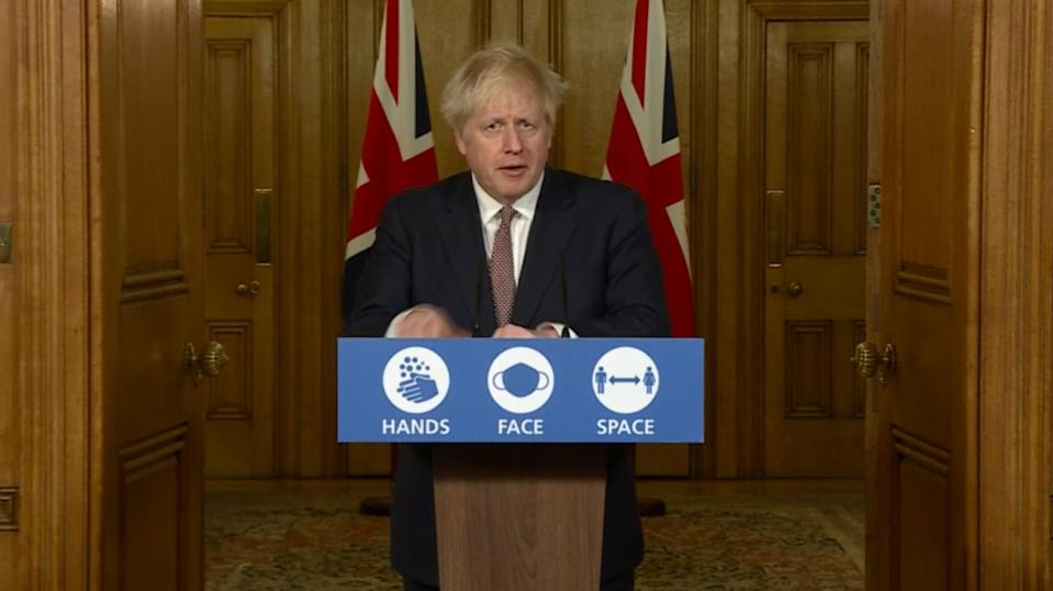 <p>Boris Johnson addresses a Downing Street press conference</p> (PA)