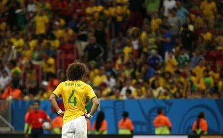Brazil's David Luiz reacts after the 2014 World Cup third-place playoff between Brazil and the Netherlands at the Brasilia national stadium in Brasilia July 12, 2014. REUTERS/Jorge Silva