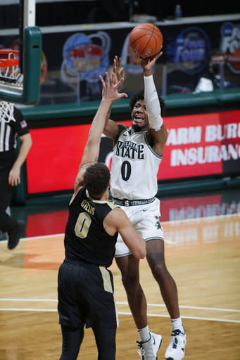 Michigan State's Aaron Henry shoots over Purdue's Mason Gillis during the second half of an NCAA college basketball game Friday, Jan. 8, 2021, in East Lansing, Mich. Purdue won 55-54. (AP Photo/Al Goldis)