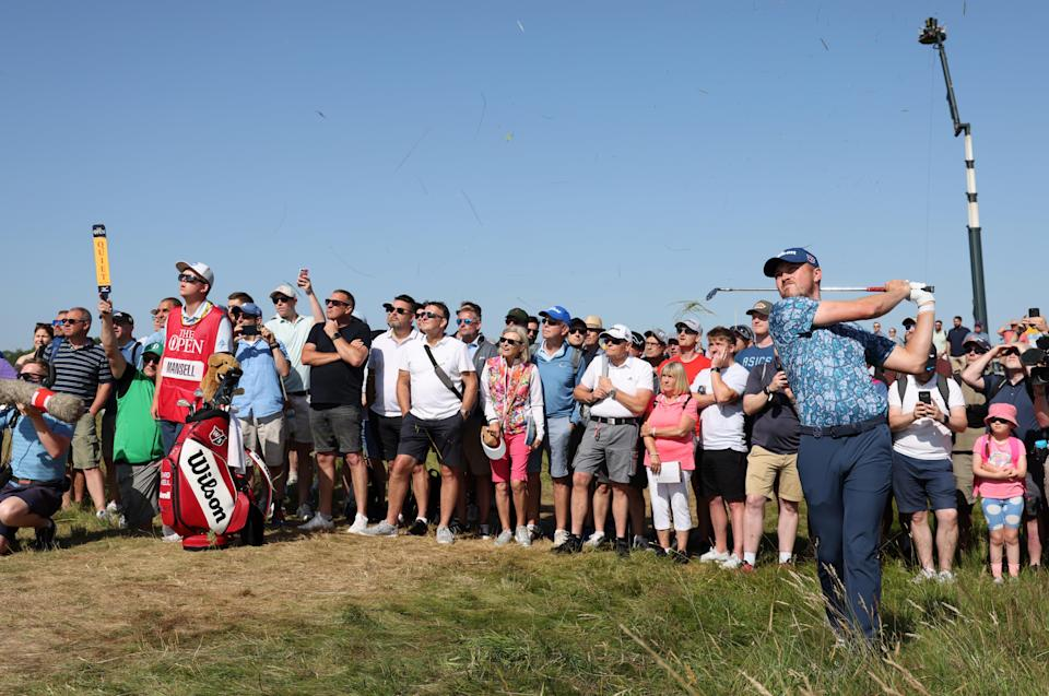 Spectators had their legs out at Sandwich in Kent as the third day of golf's The Open teed off at Royal St George's (PA) (PA Wire)