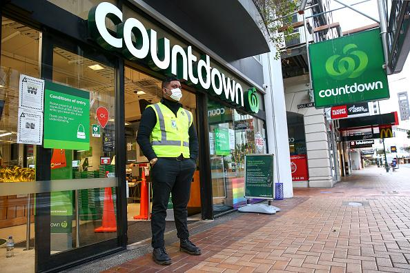 A security guard stands outside the Willis Street Countdown Supermarket during the first day of a nationwide lockdown in Wellington, New Zealand.