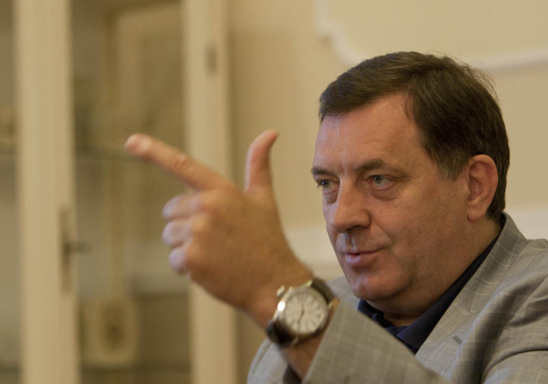"""Bosnian Serb Milorad Dodik, President of the Bosnian Serb region of Republic of Srpska, reacts during and interview with Associated Press in the Bosnian town of Banja Luka, 240 kms (150 miles) northwest of the Bosnian capital of Sarajevo Wednesday, June 15, 2011. Milorad Dodik told the AP Wednesday that the Bosnian Serbs are """"the victims of Bosnia"""" and would be much better off without being part of it. Since the end of the 1992-95 war, Bosnia has been divided into two autonomous regions one for the Serbs, the other shared by Bosnians and Croats. Bosnians are trying to unify the country, Serbs to keep their autonomy and Croats are keen on getting their own autonomous region.  (AP Photo/Amel Emric)"""