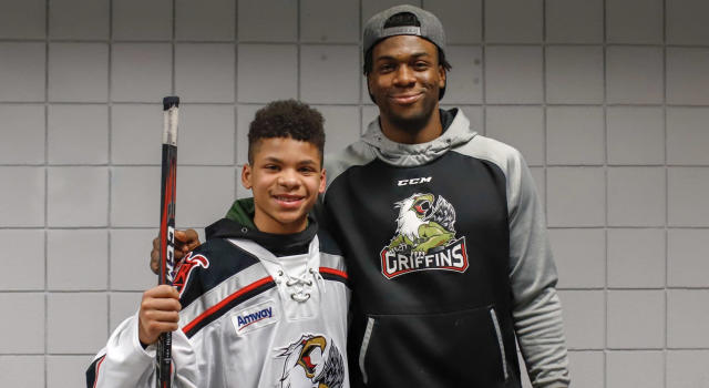 Ty Cornett meets Givani Smith after a Grand Rapids Griffins game on Friday night. (Twitter//@griffinshockey)