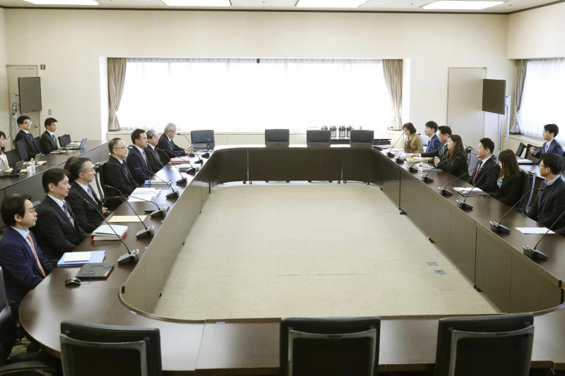 FILE - In this Dec. 16, 2019, file photo, Lee Ho-hyeon, third from right, director-general for International Trade Policy at South Korea's Trade, Industry and Energy Ministry, and Yoichi Iida, fourth from left, director-general of Japan's Trade Control Department attend a director-general level meeting at the trade ministry in Tokyo. Japan's trade ministry said Friday, Dec. 20, that it has eased controls on exports to South Korea of one of three chemicals used in semiconductors that it had restricted, a sign of a thaw between the two countries just days before their leaders meet in China. (Kyodo News via AP, File)