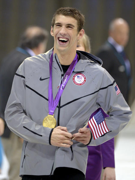 United States' swimmer Michael Phelps smiles as he wears his gold medal at the Aquatics Centre in the Olympic Park during the 2012 Summer Olympics in London, Saturday, Aug. 4, 2012. Phelps retires with twice as many golds as any other Olympian, and his total of 22 medals is easily the best mark. (AP Photo/Mark J. Terrill)