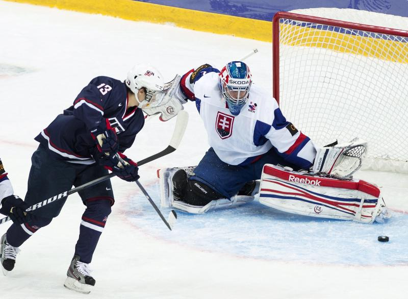 Team USA forward John Gaudreau (13) scores past Slovakia goalie Adam Nagy during first period IIHF World Junior Championships hockey action in Ufa, Russia on Monday, Dec. 31, 2012. (AP Photo/The Canadian Press, Nathan Denette)