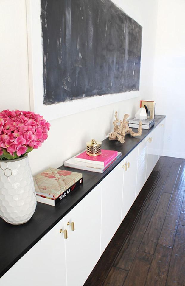"""<p>These storage centers are life savers when it comes to keeping special-occasion dishes out of the way. Plus, a sleek black countertop lined with books and accessories gives an otherwise bland wall some personality.</p><p><a href=""""http://madebygirl.blogspot.com/2011/09/floating-cabinets-are-done.html"""" target=""""_blank""""><em>See more at Made By Girl »</em></a></p>"""