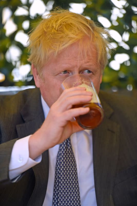 FILE PHOTO: British PM Johnson visits local elections campaign in Wolverhampton