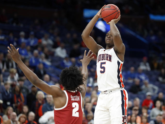 Auburn's Mustapha Heron (5) shoots over Alabama's Collin Sexton (2) during the first half in an NCAA college basketball quarterfinals game at the Southeastern Conference tournament Friday, March 9, 2018, in St. Louis. (AP Photo/Jeff Roberson)