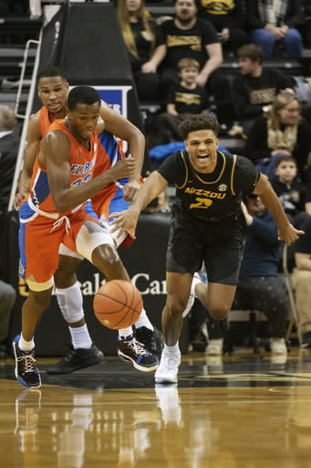 Missouri's Tray Jackson, right, and Florida's Scottie Lewis, left, battle for a loose ball during the first half of an NCAA college basketball game Saturday, Jan. 11, 2020, in Columbia, Mo. (AP Photo/L.G. Patterson)