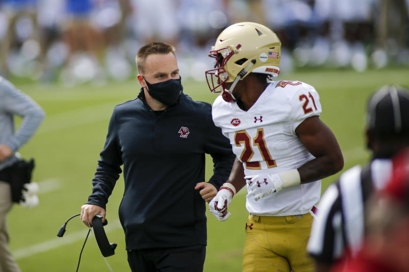 Boston College head coach Jeff Hafley, left, talks to defensive back Josh DeBerry during a game against Duke on Saturday. (Nell Redmond-Pool/Getty Images)