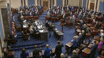 In this Jan. 26, 2021, image from video, Sen. Patrick Leahy, D-Vt., the president pro tempore of the Senate, who is presiding over the impeachment trial of former President Donald Trump, swears in members of the Senate for the impeachment trial at the U.S. Capitol in Washington. (Senate Television via AP)