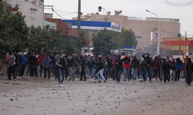 <p>Protesters throw stones during demonstrations against rising prices and tax increases, in Tebourba, Tunisia, Jan. 9, 2018. (Photo: Zoubeir Souissi/Reuters) </p>