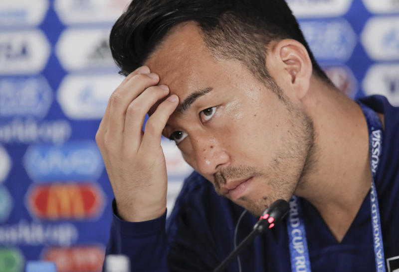 Japan's Maya Yoshida attends a press conference before Japan's official training on the eve of the group H match between Japan and Senegal at the 2018 soccer World Cup in the Yekaterinburg Arena in Yekaterinburg, Russia, Saturday, June 23, 2018. (AP Photo/Vadim Ghirda)