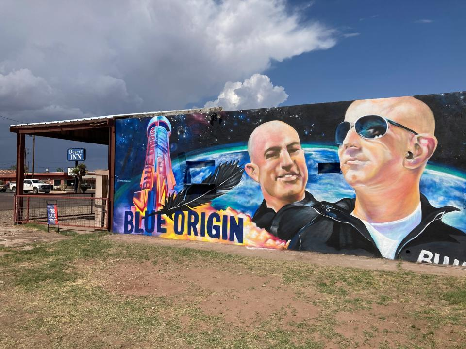 The side of a building in Van Horn, Texas, is adorned with a mural of Blue Origin founder Jeff Bezos on Saturday, July 17, 2021, just days before Bezos plans to launch into space from the Blue Origin spaceport about 25 miles outside of the West Texas town. (AP Photo/Sean Murphy)