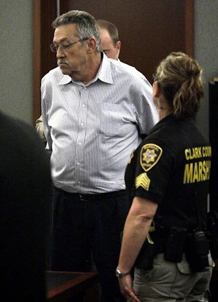 Nurse-anesthetist Ronald Lakeman is taken into custody by Clark County marshals at the Regional Justice Center in Las Vegas on Monday, July 1, 2013 after a jury found him guilty. Lakeman was found guilty of 16 of 27 charges against him, but was spared a murder conviction stemming from the death of 77-year-old former Desai patient Rodolfo Meana in April 2012. (AP Photo/Las Vegas Review-Journal, Jessica Ebelhar)