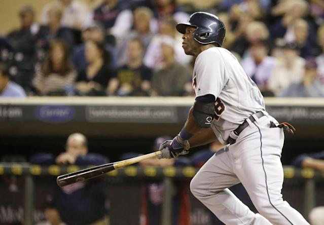 Detroit Tigers' Torii Hunter hits an RBI single during the first inning off Minnesota Twins pitcher Kevin Correia in a baseball game, Wednesday, Sept. 25, 2013, in Minneapolis. (AP Photo/Jim Mone)
