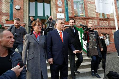 Current Hungarian Prime Minister Viktor Orban and his wife Aniko Levai leave a polling station during Hungarian parliamentary election in Budapest