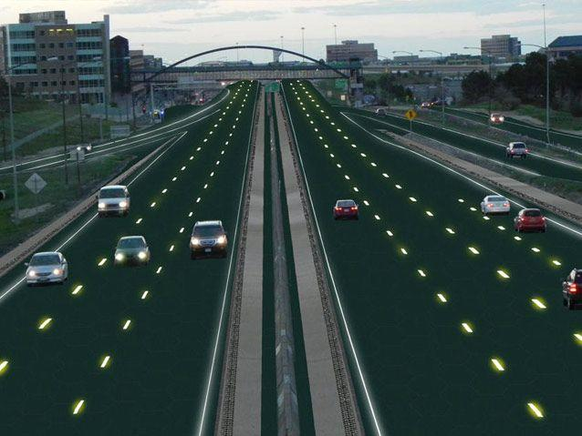 An artist's rendition of a motorway lined with solar panels. Source: Solar Roadways