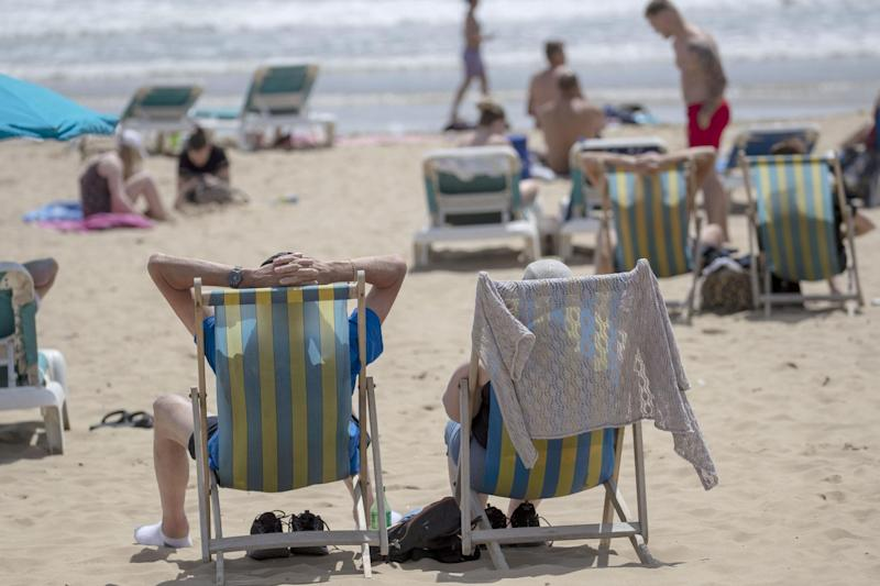 People enjoy the sunshine on the beach in Bournemouth: PA