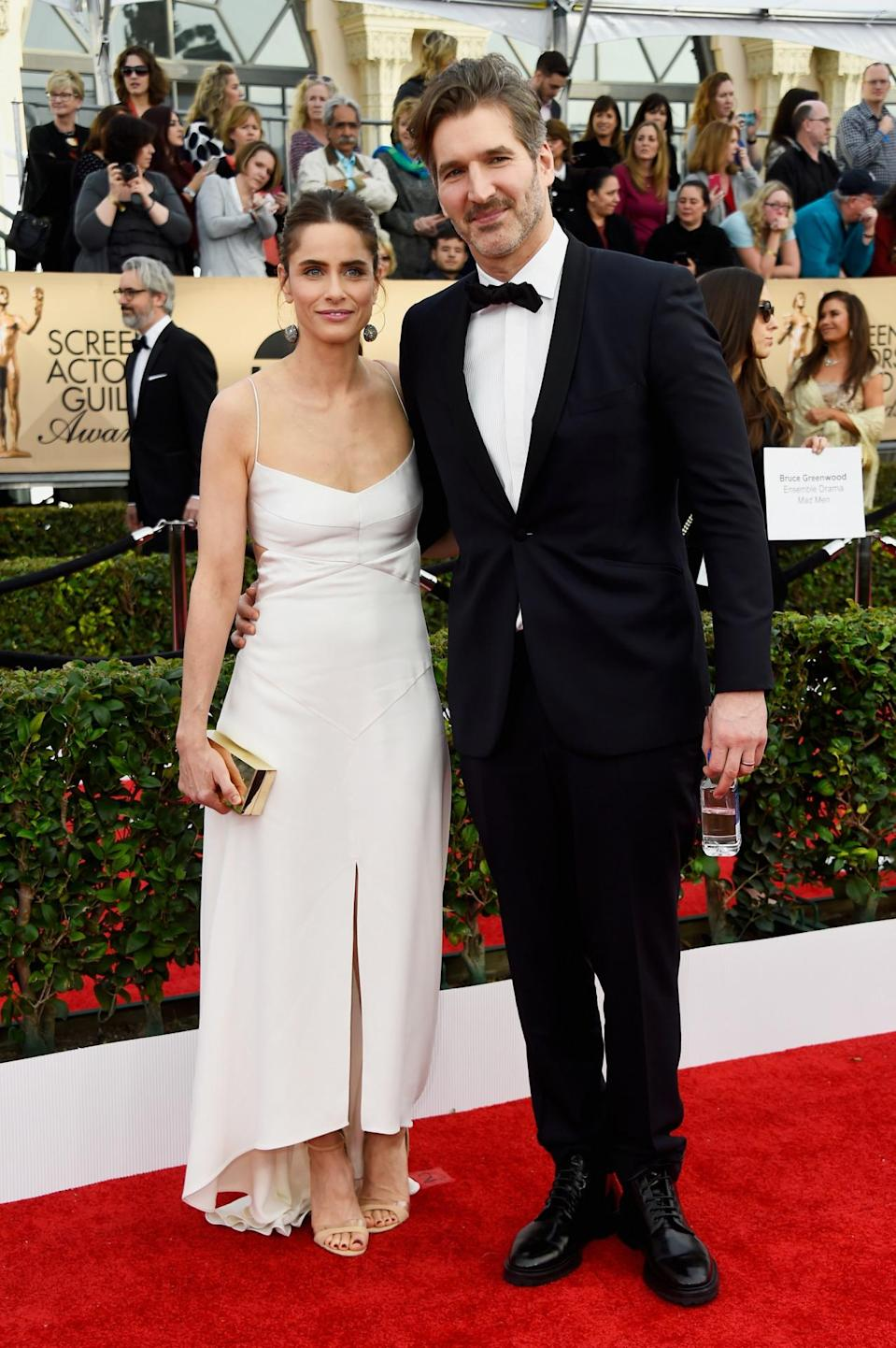 <p>Amanda Peet showed off her nude stillettos in a white midi mullet gown while posing with husband, David Benioff of <i>Game of Thrones</i> fame, on the red carpet. <i>Photo: Getty Images</i></p>