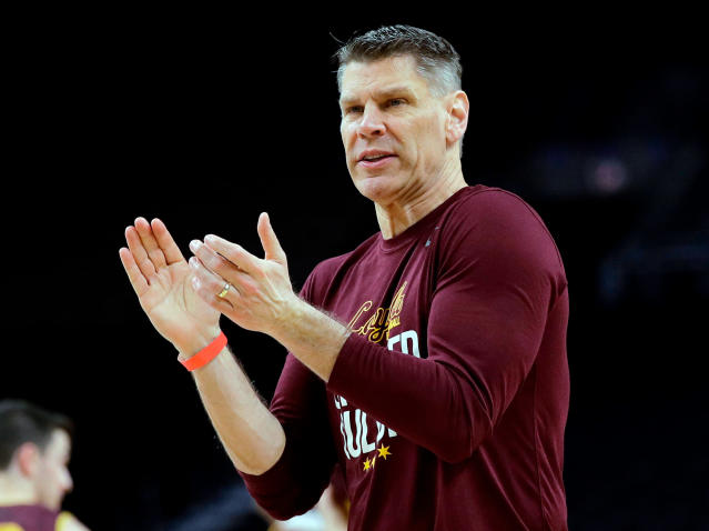 FILE - In this March 30, 2018 file photo Loyola-Chicago head coach Porter Moser reacts during a practice session for the Final Four NCAA college basketball tournament in San Antonio. Loyola-Chicago has rewarded Moser with a new contract through the 2025-26 season for a captivating Final Four run. The school announced the deal on Wednesday, April 25, 2018. (AP Photo/David J. Phillip)