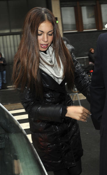 Karima el-Mahroug, the Moroccan woman at the center of ex-Premier Silvio Berlusconi's sex-for-hire trial, arrives in court to testify as a witness for the first time, in Milan, Monday, Jan. 14, 2013. El-Mahroug was ordered by the court to appear Monday to testify after failing to show on two previous dates because she was reportedly in Mexico on vacation. She has been called as a defense witness. Berlusconi is accused of paying for sex with woman, better known as Ruby, when she was 17, and then trying to cover it up. Both deny sexual contact. (AP Photo/Str)