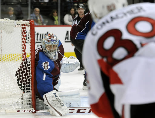 Colorado Avalanche goalie Semyon Varlamov, left, guards the net in the second period of an NHL hockey game against the Ottawa Senators on Wednesday, Jan. 8, 2014, in Denver. (AP Photo/Chris Schneider)