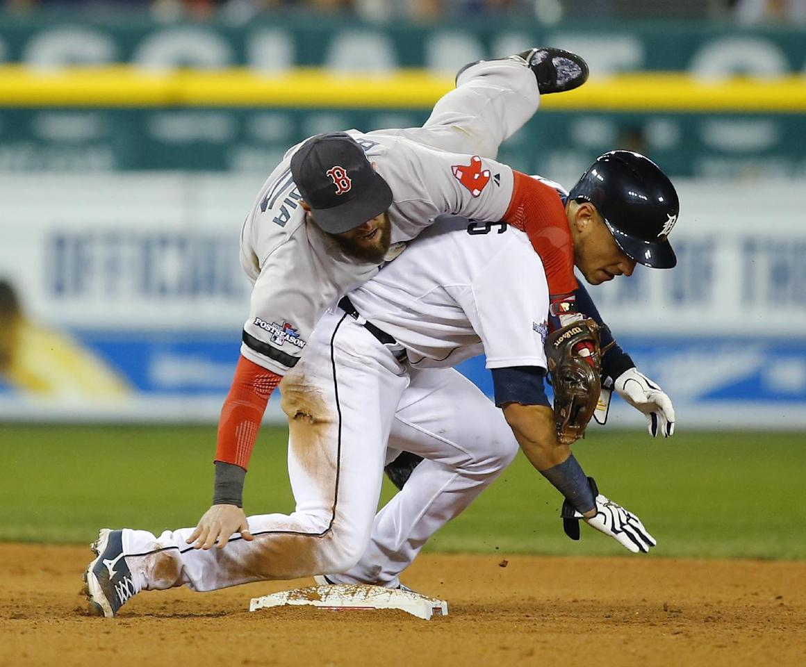 Boston Red Sox second baseman Dustin Pedroia collides with Detroit Tigers' Jose Iglesias as Pedroia tags Iglesias out on double play in sixth inning during Game 4 of the American League baseball championship series Wednesday, Oct. 16, 2013, in Detroit. (AP Photo/Paul Sancya)