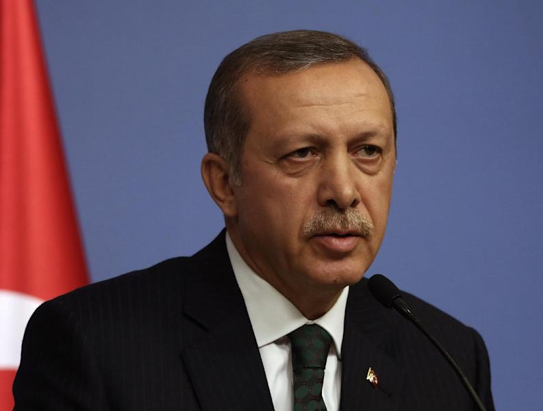 FILE - In this Dec. 18, 2013 file photo, Turkey's Prime Minister Recep Tayyip Erdogan speaks during a news conference. After a decade of dominance over Turkey's political scene, a rapidly developing corruption and bribery scandal has for the first time left Erdogan looking off balance and not in control of the political reins.(AP Photo/Burhan Ozbilici, File)