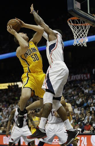 Indiana Pacers power forward Tyler Hansbrough (50) tries to get to the hoop as Atlanta Hawks small forward Josh Smith (5) defends in the first half of an NBA first-round playoff basketball game in Atlanta, Friday, May 3, 2013. (AP Photo/John Bazemore)