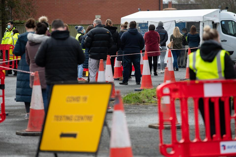 People wait to be tested for Covid (PA Wire)