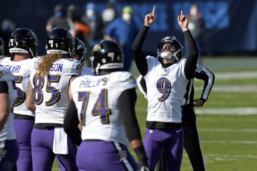 Baltimore Ravens kicker Justin Tucker (9) celebrates after kicking a 33-yard field goal against the Tennessee Titans in the first half of an NFL wild-card playoff football game Sunday, Jan. 10, 2021, in Nashville, Tenn. (AP Photo/Mark Zaleski)