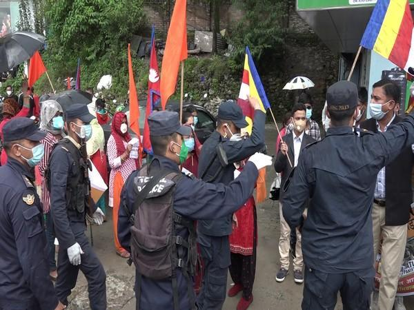Police controlling the protestors outside the Pakistan Embassy in Kathmandu on Friday