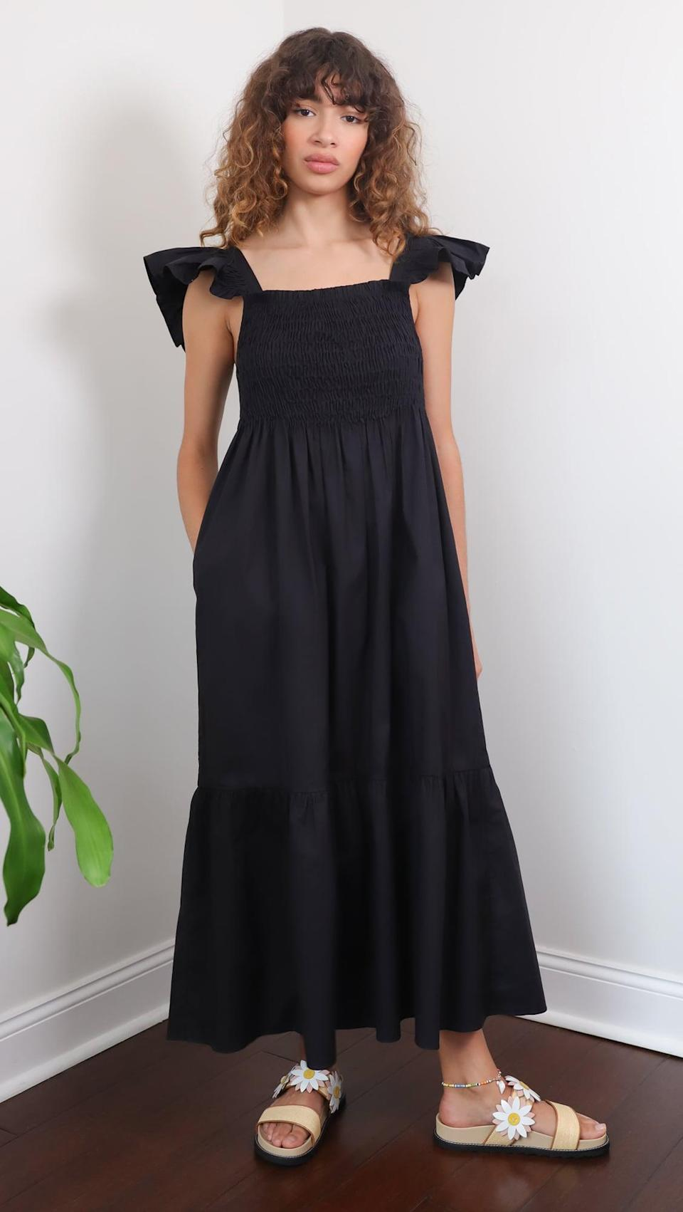 <p>This <span>Sea Varsha Cotton Smocked Ruffle Dress</span> ($395) is exactly what a summer black dress looks like.</p>