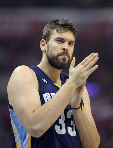 CORRECTS TO RUBS HANDS TOGETHER, NOT APPLAUDS - FILE - In this April 22, 2013, file photo, Memphis Grizzlies center Marc Gasol, of Spain, rubs his hands together during the first half of Game 2 of a first-round NBA basketball playoff series against the Los Angeles Clippers in Los Angeles. Gasol was selected as the NBA's defensive player of the year, the league announced Wednesday, April 24, 2013. (AP Photo/Mark J. Terrill, File)