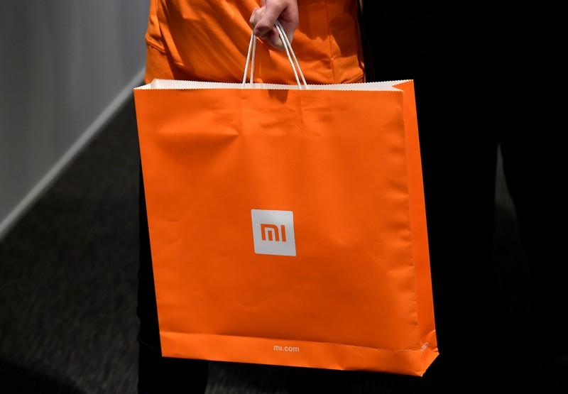 Xiaomi branding is seen on a carrier bag at a UK launch event in London