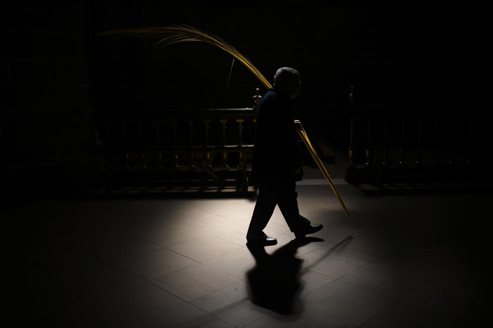 A devotee takes part in a Holy Week Palm Sunday procession at Saint Mary cathedral, in Pamplona, northern Spain, Sunday, March 28, 2021. Many devotees attended the procession a year after events were cancelled due to the outbreak of the coronavirus pandemic. (AP Photo/Alvaro Barrientos)