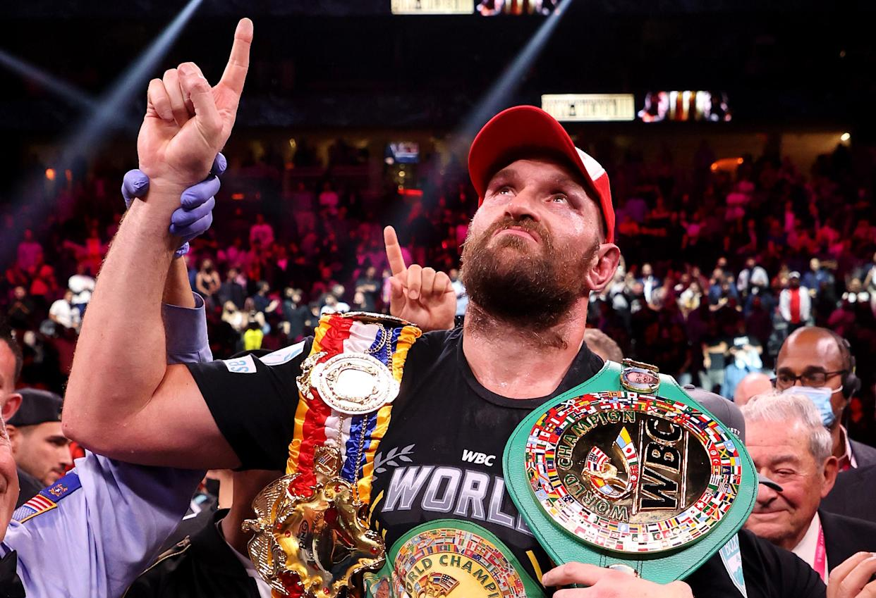 LAS VEGAS, NEVADA - OCTOBER 09: Tyson Fury celebrates his 11th round knock out win against Deontay Wilder after their WBC heavyweight title fight at T-Mobile Arena on October 09, 2021 in Las Vegas, Nevada. (Photo by Al Bello/Getty Images)