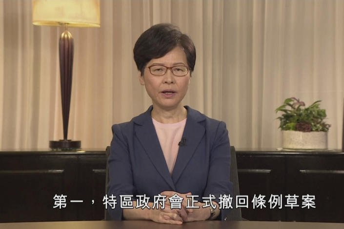 "In this image made from video provided Wednesday, Sept. 4, 2019 by Hong Kong Government Information Services, Hong Kong Chief Executive Carrie Lam speaks in the television message, in Hong Kong. Chief Executive Lam announced Wednesday the government will formally withdraw an extradition bill that sparked months of demonstrations, bowing to one of the protesters' demands in the hope of ending the increasingly violent unrest. The words, bottom, read ""First, the government will officially withdraw the bill."" (Hong Kong Government Information Services via AP)"