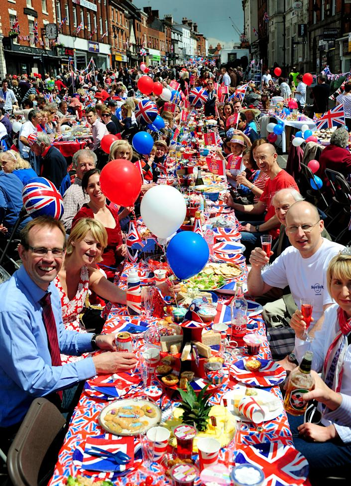 A street party to commemorate the Queen's Diamond Jubilee at Ashby De La Zouch, central England Monday June 4, 2012. Similar events and parties have been planned throughout the country to celebrate Queen Elizabeth's 60 years on the throne. (AP Photo/Rui Vieira/PA)