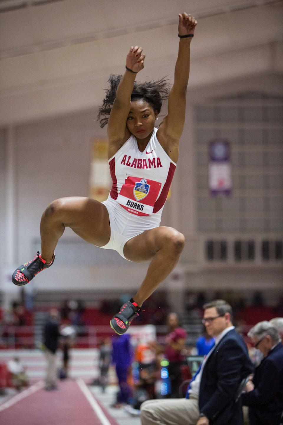 Alabama's Quanesha Burks competes in the long jump during the Southeastern Conference indoor track and field championships Friday, Feb. 26, 2016, in Fayetteville, Ark. (AP Photo/Gunnar Rathbun)
