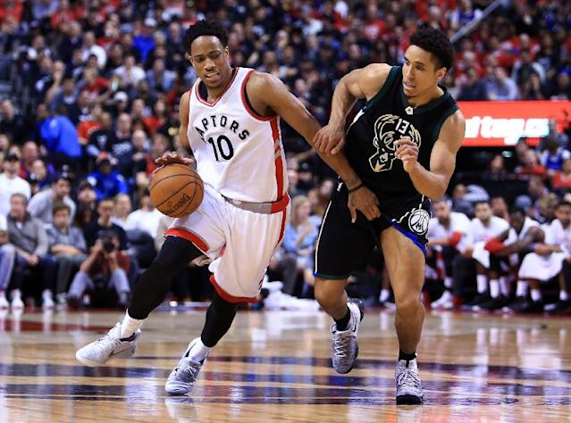 DeMar DeRozan (L) of the Toronto Raptors tries to get past Malcolm Brogdon of the Milwaukee Bucks in the second half of Game One of the Eastern Conference quarter-finals during the 2017 NBA Playoffs, in Toronto, on April 15 (AFP Photo/Vaughn Ridley)